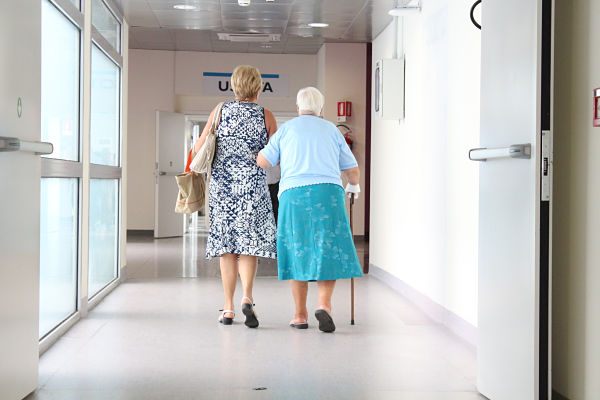 Canva - Adult Woman Walking with Her Senior Mother in the Hospital_OPTIMIZED-1